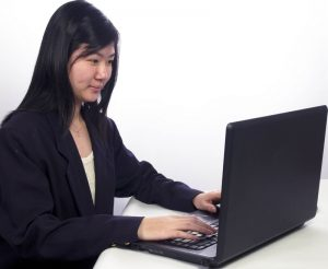 dreamstimesmall_asian girl at computer